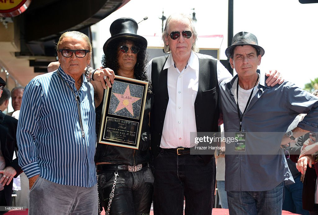 Musician Slash honored with the 2,473rd Star on the Hollywood Walk of Fame with (L-R) Producer Robert Evans, DJ Jim Ladd, Actor Charlie Sheen, outside the Hard Rock Cafe on July 10, 2012 in Hollywood, California.