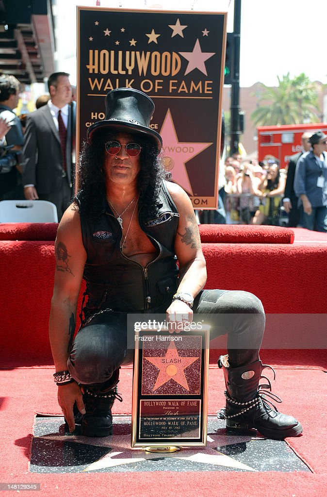 Musician Slash honored with the 2,473rd Star on the Hollywood Walk of Fame outside the Hard Rock Cafe on July 10, 2012 in Hollywood, California.