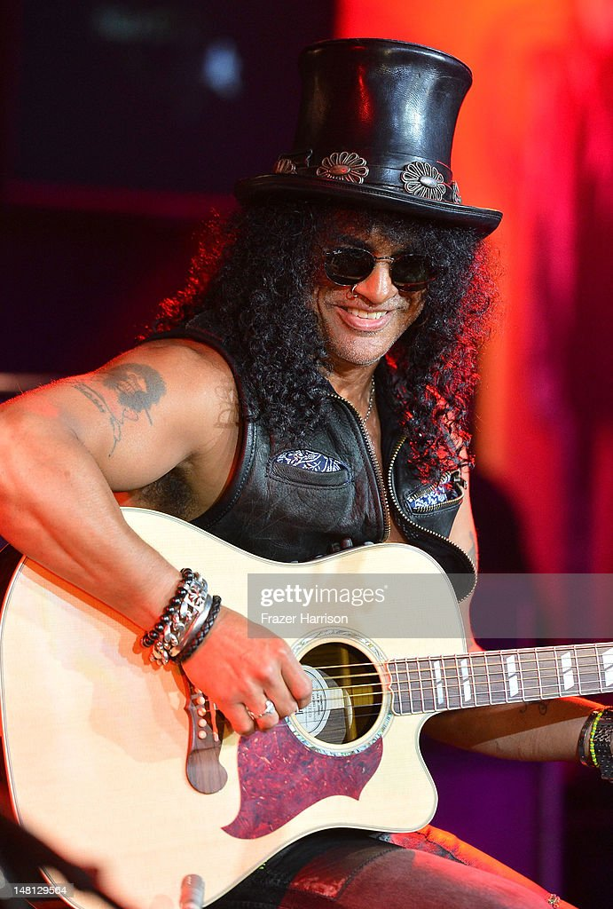 Musician Slash performs at the Hard Rock Cafe after been honored with the 2,473rd Star on the Hollywood Walk of Fame on July 10, 2012 in Hollywood, California.