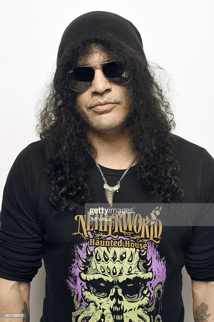 Musician Slash wears a pin to support #TackleEbola in a portrait at the Village at the Lift Presented by McDonald's McCafe during the 2015 Sundance Film Festival on January 25, 2015 in Park City, Utah.
