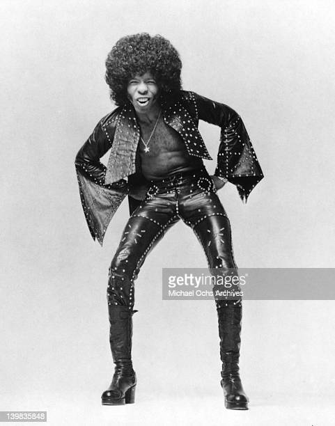 Musician Sly Stone of the psychedelic soul group 'Sly And The Family Stone' poses for a portrait holding in circa 1974