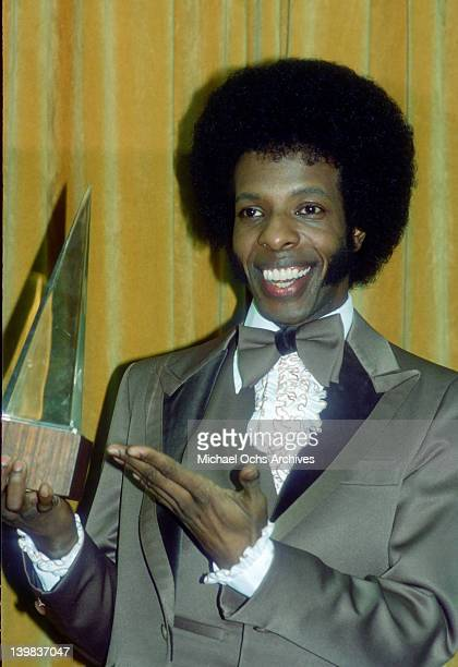 Musician Sly Stone of the psychedelic soul group 'Sly Stone And The Family Stone' poses for a portrait holding an American Muic Award in circa 1974