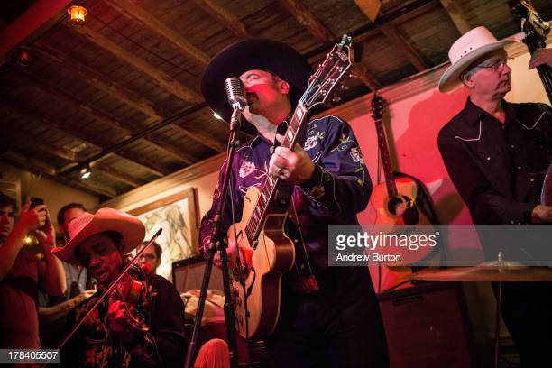 Musician Smokey Hormel plays at the reopening ceremony for Sunny's Bar a landmark bar that has been open for over a century on August 29 2013 in the...