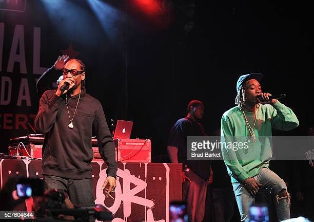 Musician Snoop Dogg and Wiz Khalifa perform at the 2nd Annual National Concert Day Show at Irving Plaza on May 3 2016 in New York City