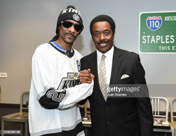 Musician Snoop Dogg poses with KCBS sportscaster Jim Hill before the game between the Colorado Avalanche and the Los Angeles Kings at STAPLES Center...