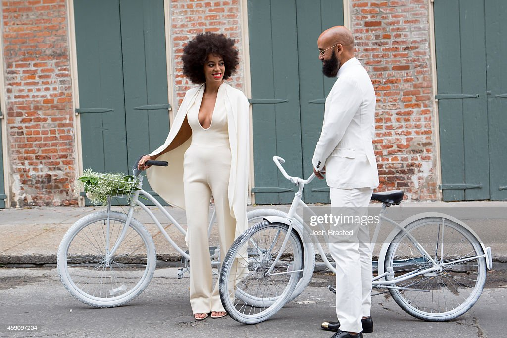 Musician Solange Knowles (wearing a pre-ceremony ensemble by Stephane Rolland) and her fiance, music video director Alan Ferguson, ride bicycles on the streets of the French Quarter en route to their wedding ceremony at the Marigny Opera House on November 16, 2014 in New Orleans, Louisiana.
