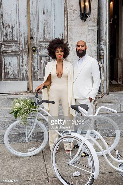 Musician Solange Knowles and her fiance, music video director Alan Ferguson, ride bicycles on the streets of the French Quarter en route to their...