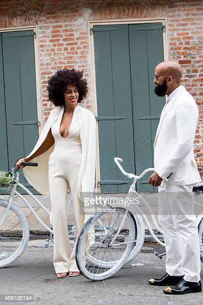 Musician Solange Knowles and her fiancee, music video director Alan Ferguson ride bicycles on the streets of the French Quarter en route to their...