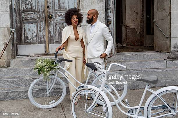 Musician Solange Knowles and her fiancee music video director Alan Ferguson ride bicycles on the streets of the French Quarter en route to their...