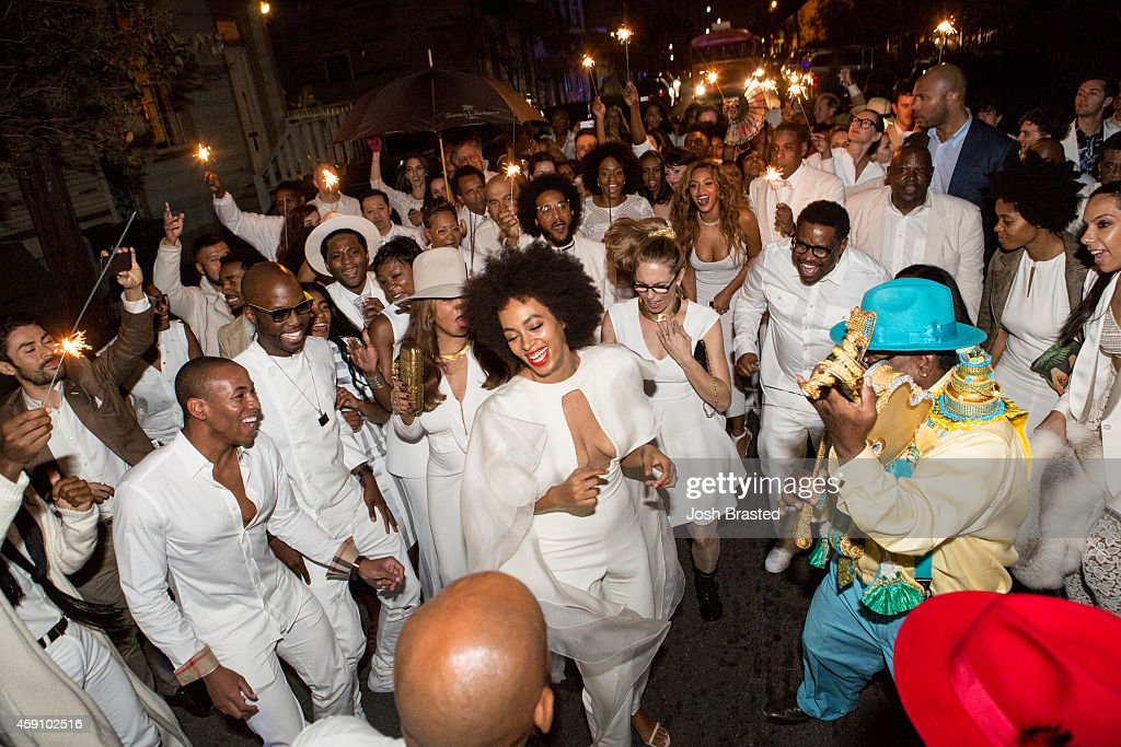 Musician Solange Knowles (C) and her new husband, music video director Alan Ferguson second line in the streets of New Orleans with family and guests after her wedding on November 16, 2014 in New Orleans, Louisiana.