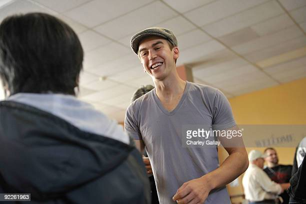 Musician Spencer Day passes out food to residents of the Tenderloin district at the Feeding America Food Bank on October 22 2009 in San Francisco...