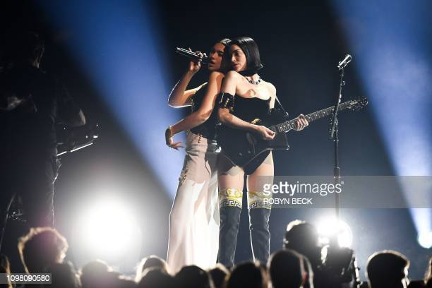 US musician St Vincent and English singersongwriter Dua Lipa perform onstage during the 61st Annual Grammy Awards on February 10 in Los Angeles
