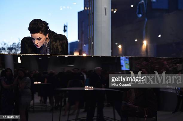 Musician St Vincent wearing Max Mara performs at the Max Mara celebration of the opening of The Whitney Museum Of American Art at its new location on...