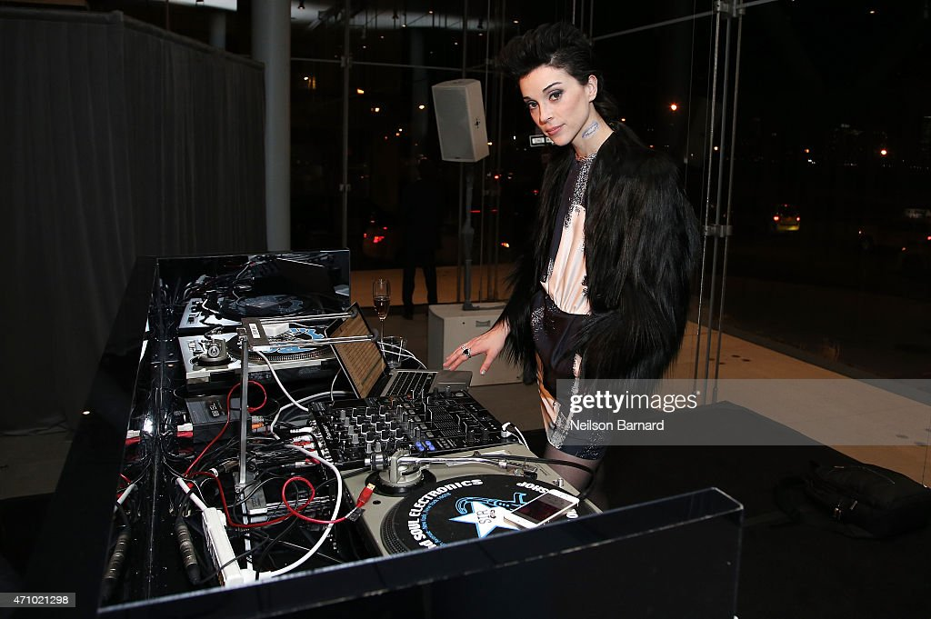 Musician St. Vincent, wearing Max Mara, performs at the Max Mara celebration of the opening of The Whitney Museum Of American Art at its new location on April 24, 2015 in New York City.