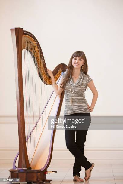 Musician standing with harp