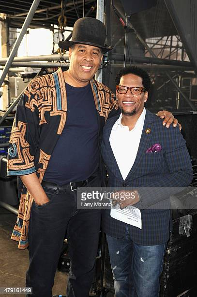 Musician Stanley Clarke and Host DL Hughley attend Day 2 of Jazz In The Gardens at Sun Life Stadium on March 16 2014 in Miami Gardens Florida
