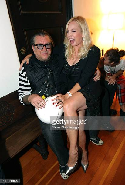 Musician Steve Jones of the Sex Pistols and actress Tracy Lords back stage at the Johnny Ramone 10th Anniversary Celebration at Hollywood Forever on...