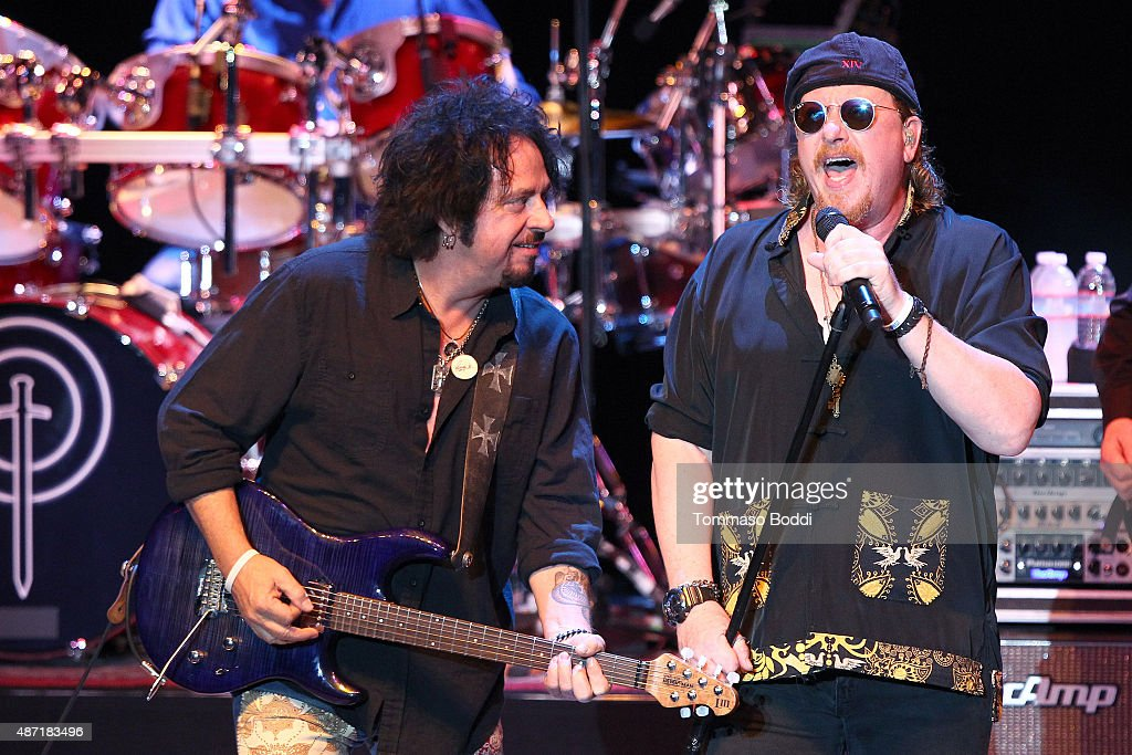 Musician Steve Lukather and singer Joseph Williams of Toto perform at The Greek Theatre on September 6, 2015 in Los Angeles, California.