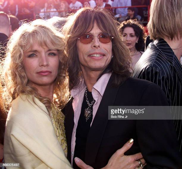 Musician Steve Tyler and Cyrinda Foxe at the 71st Annual Academy Awards, March 21,1999 In Los Angeles, California.
