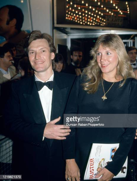 Musician Steve Winwood and his wife Eugenia Crafton attending the premiere of 'Buster' at the Odeon Leicester Square in London England on 16...