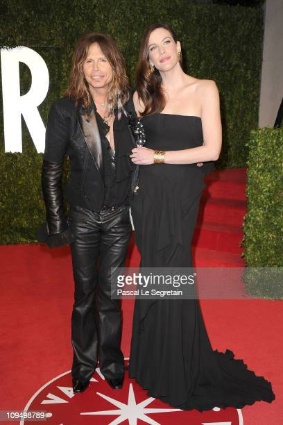 Musician Steven Tyler and actress Liv Tyler arrive at the Vanity Fair Oscar party hosted by Graydon Carter held at Sunset Tower on February 27, 2011...