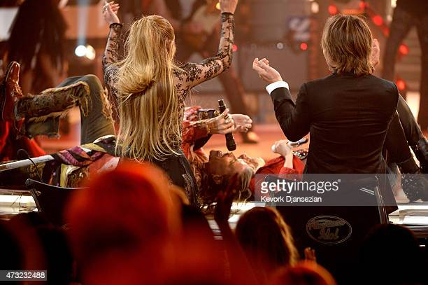 Musician Steven Tyler and finalist Jax perform onstage with American Idol judges Jennifer Lopez and Keith Urban during American Idol XIV Grand Finale...