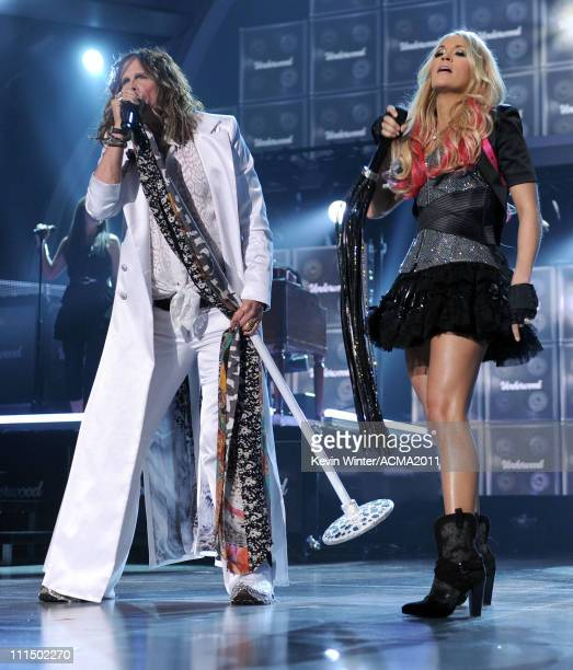 Musician Steven Tyler and singer Carrie Underwood perform onstage during the 46th Annual Academy of Country Music Awards held at the MGM Grand Garden...