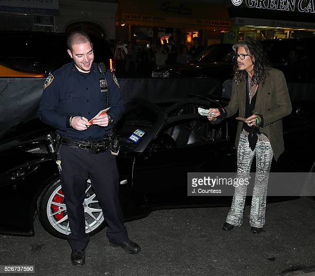 Musician Steven Tyler haggles over a parking ticket prior to the 'Steven TylerOut On A Limb' Kick Off Celebration at Lavo on April 30 2016 in New...