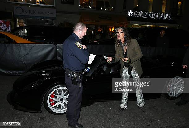 """Musician Steven Tyler haggles over a parking ticket prior to the """"Steven Tyler...Out On A Limb"""" Kick Off Celebration at Lavo on April 30, 2016 in New..."""