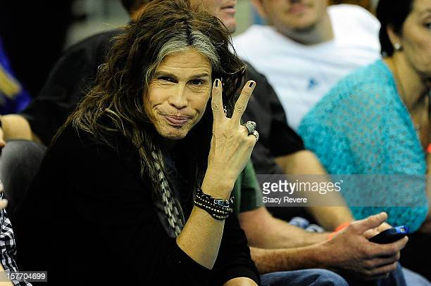 Musician Steven Tyler sits court side at a game between the Los Angeles Lakers and the New Orleans Hornets at the New Orleans Arena on December 5...