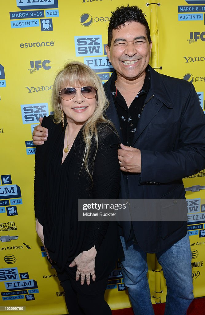 Musician Stevie Nicks (L) and musician Pat Smear arrives at the screening of 'In Your Dreams:Stevie Nicks' during the 2013 SXSW Music, Film + Interactive Festival at the Paramount Theatre on March 14, 2013 in Austin, Texas.