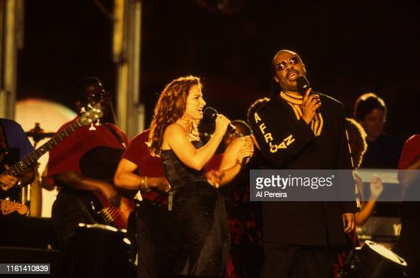 Musician Stevie Wonder and Gloria Estefan performing at Superbowl XXXIII Halftime on January 31 1999 in Miami