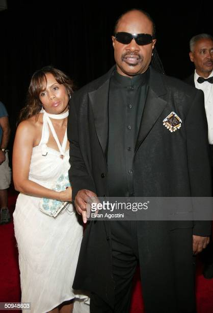 Musician Stevie Wonder and wife attend the 35th Annual Songwriters Hall of Fame induction ceremony at the Marriott Marquis June 10 2004 in New York...