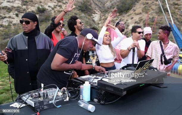 Musician Stevie Wonder DJ MalSki Sophia Morris Kwame Morris Kai Millard Keita Morris Chad Millard and Kailand Morris onstage at MANDAFEST Mandla...