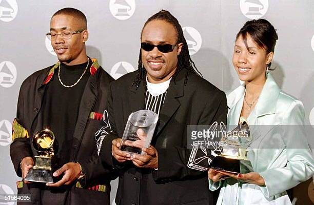 Musician Stevie Wonder holds a Lifetime Achievement award as his son Keita and daughter Aishia Morris hold his Grammy Awards for Best Male R B Vocal...