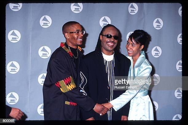 Musician Stevie Wonder stands with his children at the 38th Annual Grammy Awards February 28 1996 in Los Angeles CA Wonder won the Best Rhythm and...