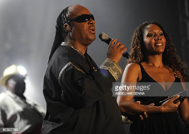 US musician Stevie Wonder with his daugther Aicha performs on stage during the eighth Mawazine international music festival in Rabat on May 23 2009...
