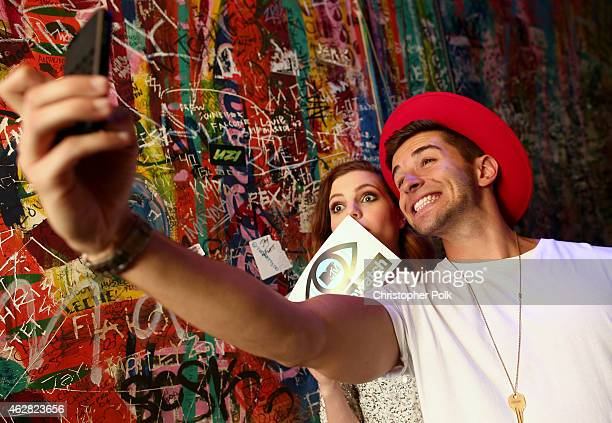Musician Sydney Sierota of Echosmith and Rapper Jake Miller take a selfie backstage during MTV Artists to Watch at House of Blues Sunset Strip on...