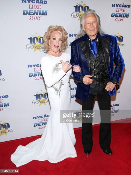Musician Tanya Tucker and designer Peter Nygard attend the 27th Annual Night Of 100 Stars Black Tie Dinner Viewing Gala at the Beverly Hilton Hotel...