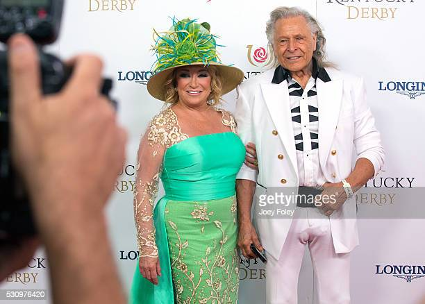Musician Tanya Tucker and executive Peter Nygard attends the 142nd Kentucky Derby at Churchill Downs on May 07 2016 in Louisville Kentucky