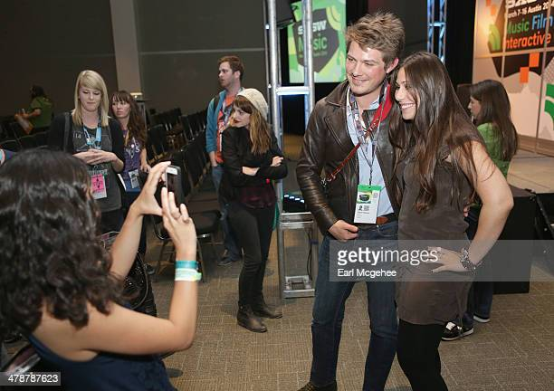 Musician Taylor Hanson takes a photo with a fan at 'When to Tune Out the Trainwreck' during the 2014 SXSW Music Film Interactive Festival at Austin...