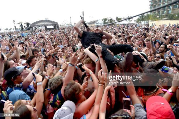 Musician Taylor Rice of the band Local Natives crowd surfs as he performs at the Surf Stage during 2017 Hangout Music Festival on May 20 2017 in Gulf...