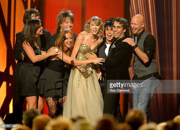 Musician Taylor Swift accepts the award for Entertainer of the Year onstage during the 43rd Annual CMA Awards at the Sommet Center on November 11...