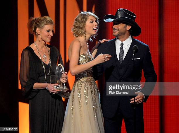 Musician Taylor Swift accepts the award for Entertainer of the Year from singers Faith Hill and Tim McGraw onstage during the 43rd Annual CMA Awards...
