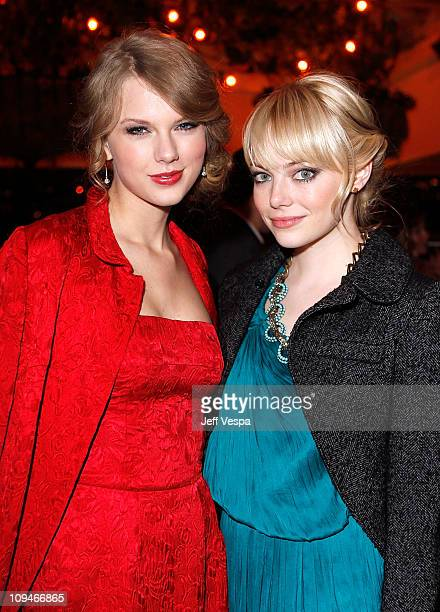Musician Taylor Swift and Actress Emma Stone attend the Montblanc Cocktail Party cohosted by Harvey and Bob Weinstein celebrating the Weinstein...