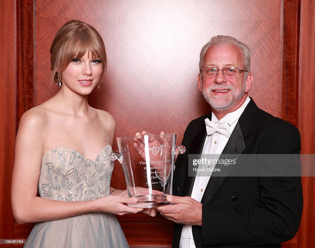 Musician Taylor Swift and Alan Valentine attend the annual Nashville Symphony Ball at the Schermerhorn Symphony Center on December 10, 2011 in Nashville, Tennessee. Swift, a 4-time GRAMMY winner, was honored with the Nashville Symphony's prestigious Harmony Award, recognizing her for exemplifying the unique harmony between the many worlds of music that exist in Nashville, and her significant contributions to the development and appreciation of musical culture. Earlier this month Swift was feted by Billboard magazine as their 2011 Woman of the Year, the youngest artist ever to receive this top honor. Last month she won Artist of the Year at the American Music Awards and was named Entertainer of the Year by the Country Music Association.