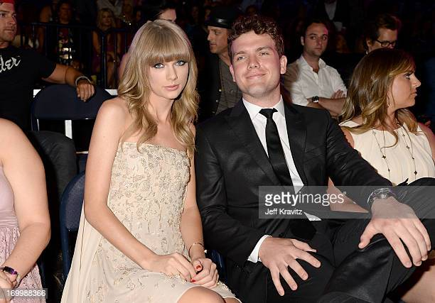 Musician Taylor Swift and brother Austin Swift attend the 2013 CMT Music Awards at the Bridgestone Arena on June 5 2013 in Nashville Tennessee