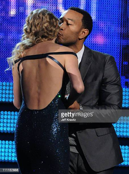 Musician Taylor Swift and John Legend onstage during the 52nd Annual GRAMMY Awards held at Staples Center on January 31 2010 in Los Angeles California