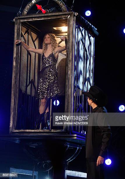 Musician Taylor Swift and magician David Copperfield perform onstage during the 44th annual Academy Of Country Music Awards held at the MGM Grand on...