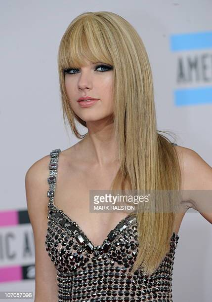 Musician Taylor Swift arrives on the red carpet of the 2010 American Music Awards at the Nokia Theatre in Los Angeles on November 21 2010 AFP...